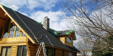 Roof repair and replacement is our specialty. Here we are installing stone coated metal roofing.