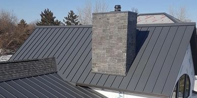 Bozeman, MT Roofing Companies installing standing seam metal roofing