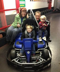 Happy family enjoying watching their son drive the electric cadet karts at JDR Karting Gloucester