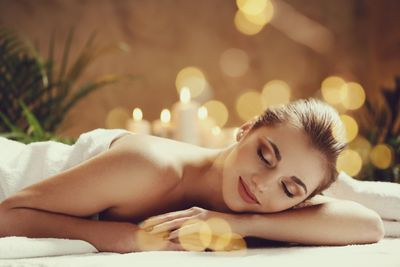 Relaxed and smiling woman having massage