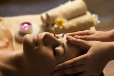 Relaxed woman having facial massage