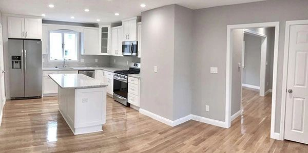 kitchen remodel island with one foot overhang appliances wood look flooring gray and white decor black and stainless appliances can lights