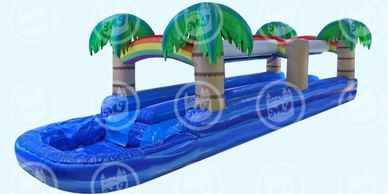 Add a piece of paradise into your backyard! The Tropical Dual Slide N Splash beautifully resembles w