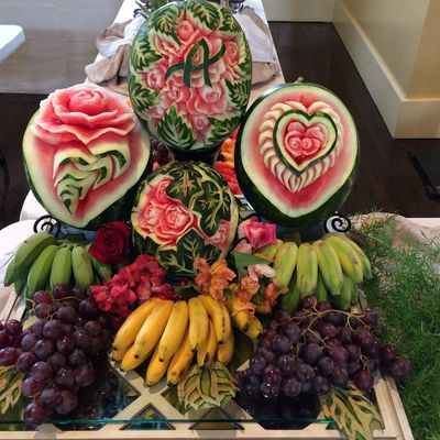 A fruit centerpiece for a wedding reception with monogram.