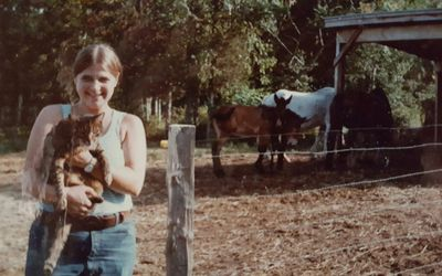 Ruth A. De Gennaro  with mares &  mule foals at one of the sheltered feed stations age 14