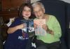 "My oldest granddaughter, Anabelle, with ""Miss Emily,"" who bought both books."