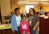 Me with LaTonya and her two daughters at Authors' Day.