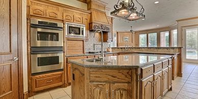 Huge kitchen with brown cabinets
