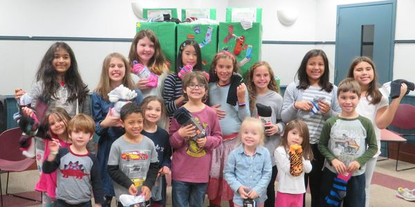 Each Oct, kids do community service by showing that the smallest act of love, donating a pair of socks, can make a big difference for the homeless - Socktober.