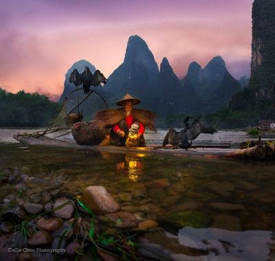The quintessential image of Guilin - the cormorants fisherman by the gorgeous Li River.