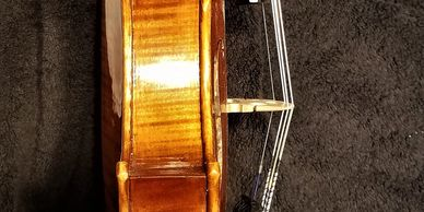 Side view 5 string violin.