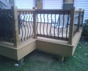 Evergain composite deck with cedar rails and metal balusters