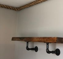 Custom live edge shelf with rope crown molding