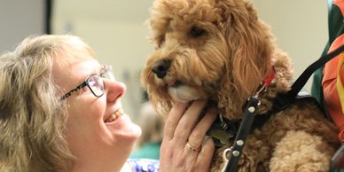Therapy Dog Chester brings smiles to everyone he meets!