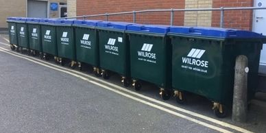 1100L Mixed Recycling bins by Wilrose Waste outside a hospital in SW London.