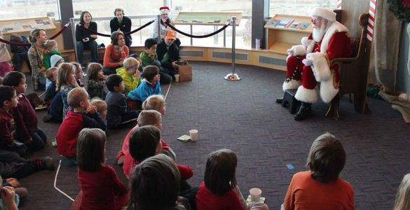 Santa tells stories to children and adults