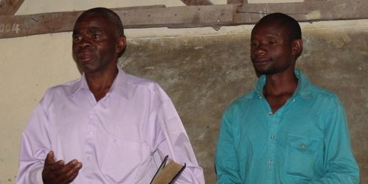 Pastor Daka teaching the Word in Bemba and Pastor Simon translating to Lambya