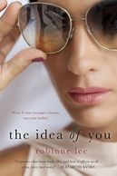 A book cover titled The Idea of You by Robinne Lee with a woman wearing sunglasses and pink lipstick and pink nail polish