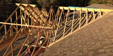 Here we are adding framing to a existing roof to create a front porch.