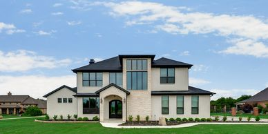 Luxury custom home on 3+ acres. Designed with white austin stone, white painted brick, and bronze windows.