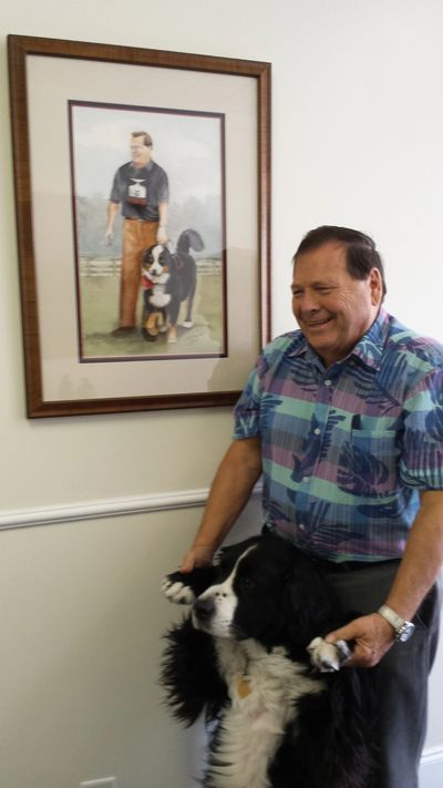 Robert A. Baille with his guide dog DJ.