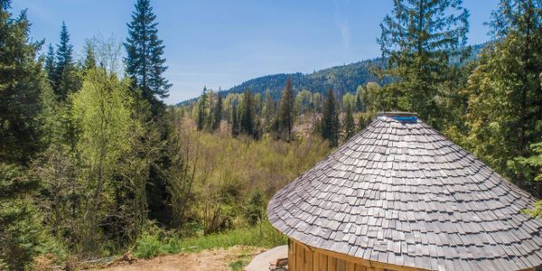 Off grid, 11 acres, electricity near by. Spring and creek, yurt, unfinished shop with living quarter