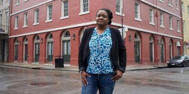 Ret. U.S. Army Maj. Tracy Riley stands in front of her French Quarter business.