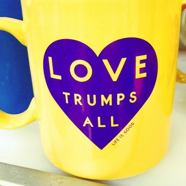 Love trumps all coffee mug.