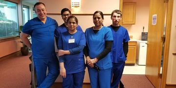 students pose for a picture in there scrubs