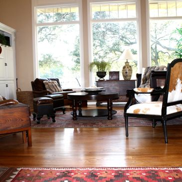 mixing new with antique furnishings, both modern and antique and native art play well together