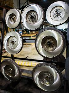 a rack of resurfaced flywheels for exchange at H&H Truck Parts in Cleveland, OH at their commercial truck repair shop
