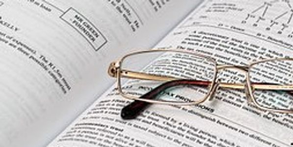 Eyeglasses placed on financial book