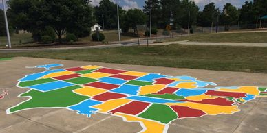 Encourage imaginative play at your school with art.  Playground murals enhance concrete areas.