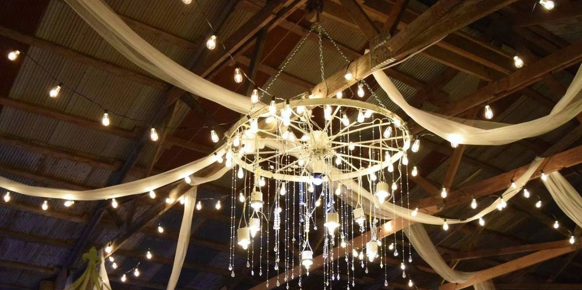 Wedding Reception, Outdoor Venue, first dance under wagon wheel chandelier