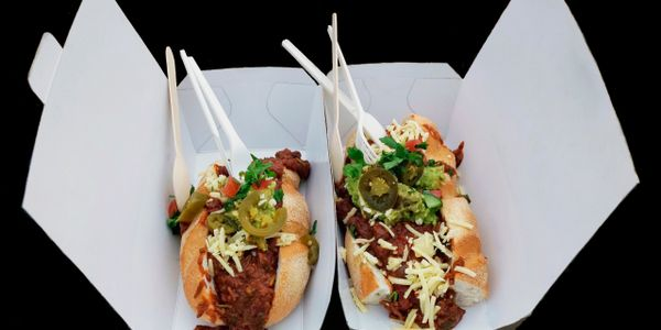 Delicious street food. Chille hot dog with jalapeño sausage