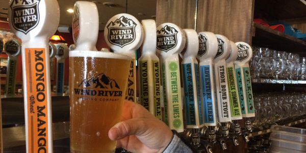 wind river beer in front of taps