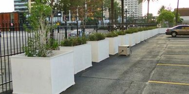 Large Line of Planters in a Parking Lot