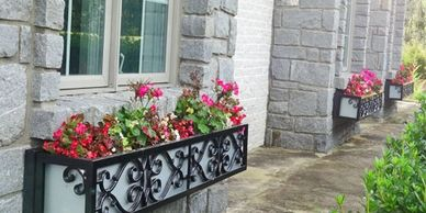 Historic Wrought Iron Window Boxes on Stone Home