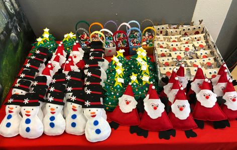 Sponsor, Volunteer, Decorate a Tree or Wreath, or make something for our Elf Emporium Boutique!