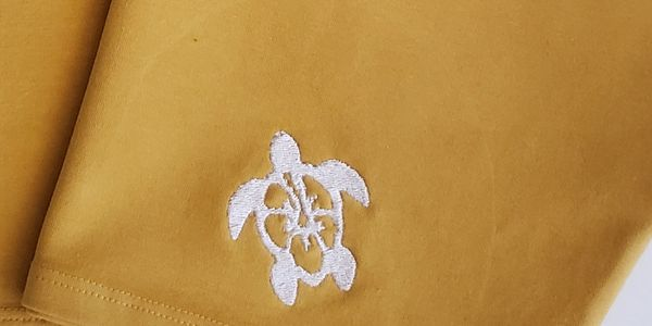 Hibiscus flower embroidered on the sea turtle (Hibiscus Sea Turtle) clothes by AKO wear Hawaii.