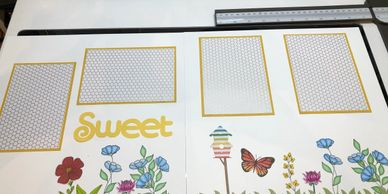 Sweet 2-page scrapbook layout with flowers, butterfly, birdhouse, and place holders for four photos.