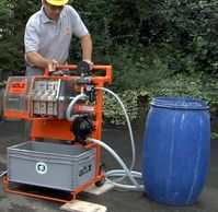 Portable filter press removes fine silt from water for reuse.