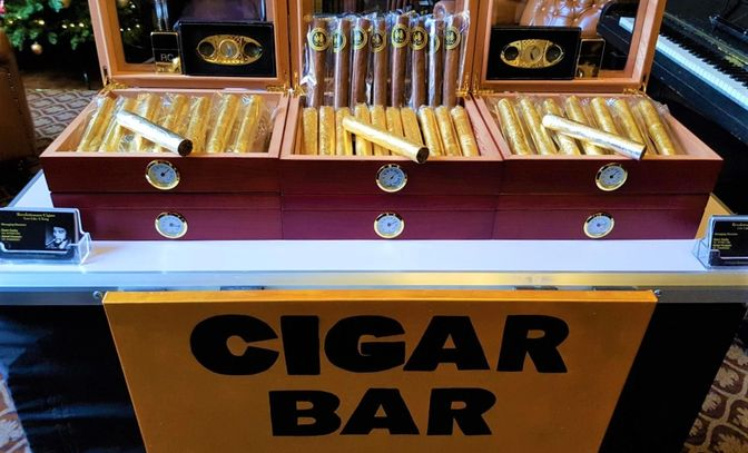 Millionaire package is a Luxury Wedding Cigar Bar, fully stocked with 24CT Gold leaf Cigars.