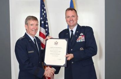 Brigadier General Carl Buhler retirement officiated by General Hawk Carlisle.