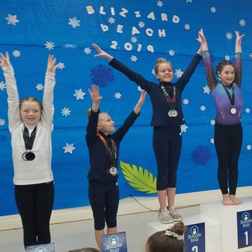 Gymnasts on the podium at 2019 Blizzard Beach