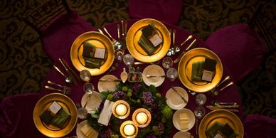 Beautiful Jewel Colored table with gold chargers and local Milwaukee's own Indulgence Chocolates.