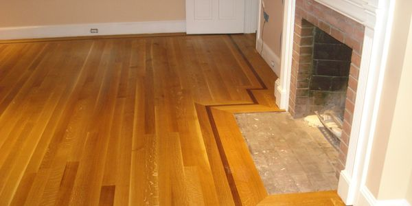 Quartersawn white oak with walnut feature strip.