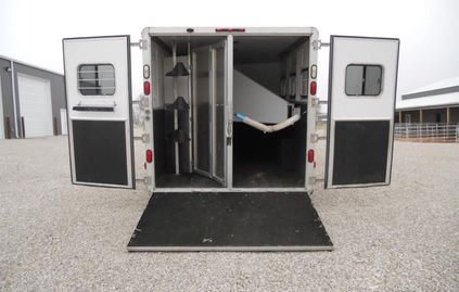 We have years of experience handling horses. We haul in an aluminum GN LQ horse trailer.