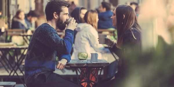 young couple drinking coffee in a coffee shop