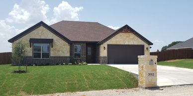 Split bed arrangement  in this 4 bedrooms, 2 bathrooms 2,077SF home. Open floor plan vaulted ceiling